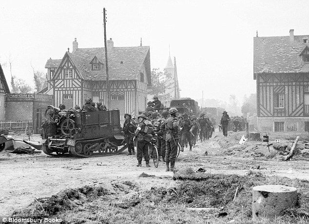 British troops advance through the village of Hermanville-sur-Mer, Normandy, on D-Day itself